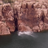Cliff Diver Falls From Ledge, Scapes the Rock Face and Bellyflops into the Water [Video]