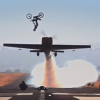 Dirt Bike Does Massive Back Flip Over A Low-Flying Plane In Amazing Video