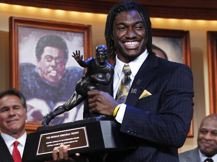Robert Griffin III moves pro day to avoid Andrew Luck hype....