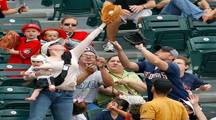 Here's a Dad With a Baby Trying to Catch a Home Run Ball at Reds Game