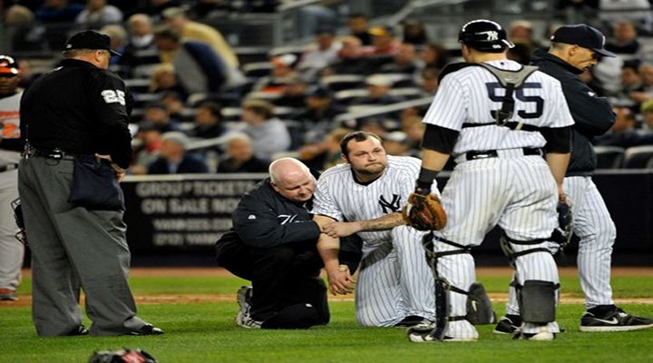 Joba Chamberlain Knocked Out of Game By Flying Bat; Orioles Beat Yankees 2-1 In Extras, Force Game 5