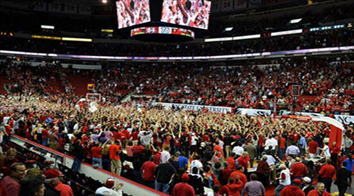 N.C. State Fans Rushing Court After Duke Upset Knocked Over Fan in Wheelchair [Video]