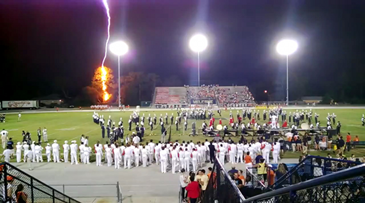 Band Continues to Play as Lightning Strikes Tree REALLY Close to High School Football Field During Halftime Show [Video]