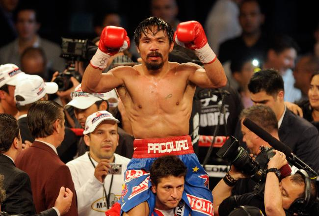 hi-res-132638878-manny-pacquiao-celebrates-his-majority-decision-victory_crop_north