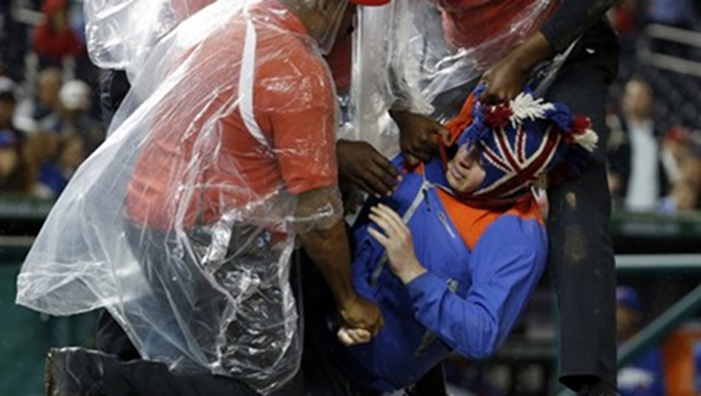 463202__blenderss-nats-journal-jungle-bird-man-runs-onto-field-during-nationals-mets-game-tackled-by-security