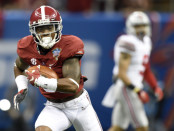 Jan 1, 2015; New Orleans, LA, USA; Alabama Crimson Tide defensive back Cyrus Jones (5) runs the ball after an interception during the first half against the Ohio State Buckeyes in the 2015 Sugar Bowl at Mercedes-Benz Superdome. Mandatory Credit: John David Mercer-USA TODAY Sports