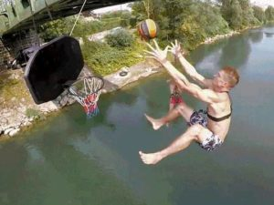 Swinging-From-a-Bridge-Makes-Basketball-Dunks-Impossibly-Impressive